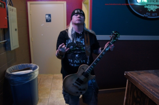 in awe that I am holding a guitar given to Justin by Zakk Wylde.